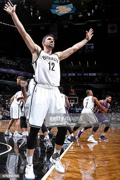 Joe Harris of the Brooklyn Nets defends and inbound play during the game against the Sacramento Kings on November 27 2016 at Barclays Center in...