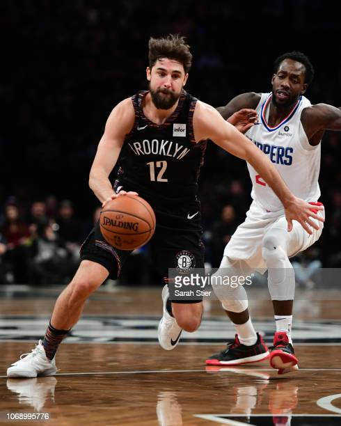 Joe Harris of the Brooklyn Nets dribbles past Patrick Beverley of the LA Clippers during the game at Barclays Center on November 17 2018 in New York...