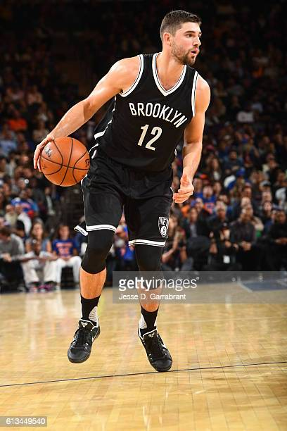 Joe Harris of the Brooklyn Nets dribbles the ball against the New York Knicks in a preseason game at Madison Square Garden on October 8 2016 in New...