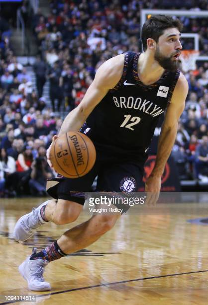 Joe Harris of the Brooklyn Nets dribbles the ball during the second half of an NBA game against the Toronto Raptors at Scotiabank Arena on January 11...