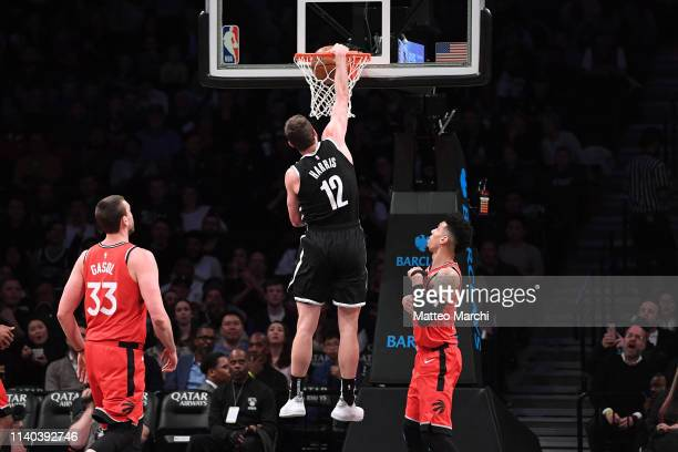 Joe Harris of the Brooklyn Nets dunks the ball against Danny Green of the Toronto Raptors during the game at Barclays Center on April 3 2019 in the...