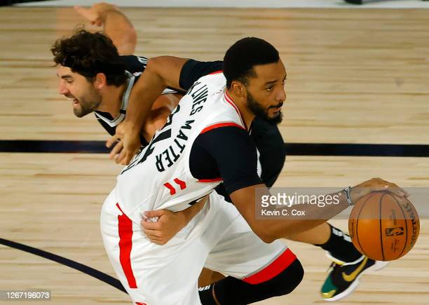 Joe Harris of the Brooklyn Nets foulds Norman Powell of the Toronto Raptors after Powell steals the ball during the third quarter in Game Two of the...