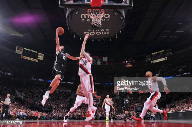 Joe Harris of the Brooklyn Nets goes to the basket against the Portland Trail Blazers on March 25 2019 at the Moda Center in Portland Oregon NOTE TO...