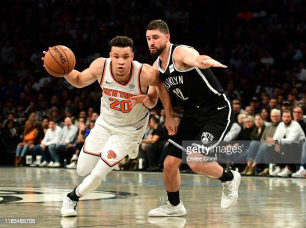 Joe Harris of the Brooklyn Nets guards Kevin Knox II of the New York Knicks as he dribbles the ball during the second half of their game at Barclays...