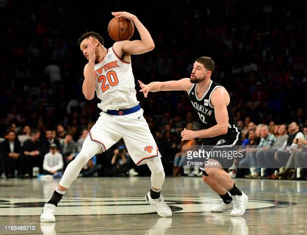 Joe Harris of the Brooklyn Nets guards Kevin Knox II of the New York Knicks as he controls the ball during the second half of their game at Barclays...