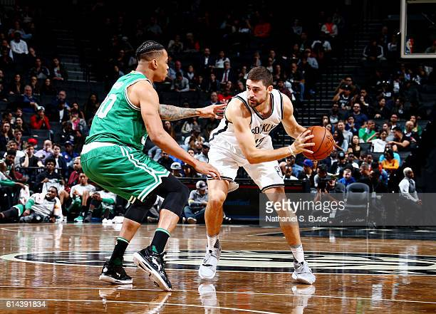 Joe Harris of the Brooklyn Nets handles the ball against Gerald Green of the Boston Celtics during a preseason game on October 13 2016 at Barclays...