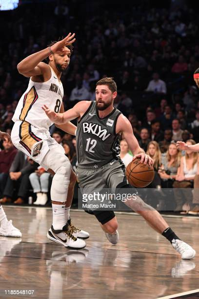 Joe Harris of the Brooklyn Nets handles the ball against Jahlil Okafor of the New Orleans Pelicans during the game at Barclays Center on November 04...