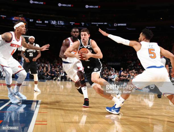 Joe Harris of the Brooklyn Nets handles the ball against the New York Knicks during the preseason game on October 3 2017 at Madison Square Garden in...