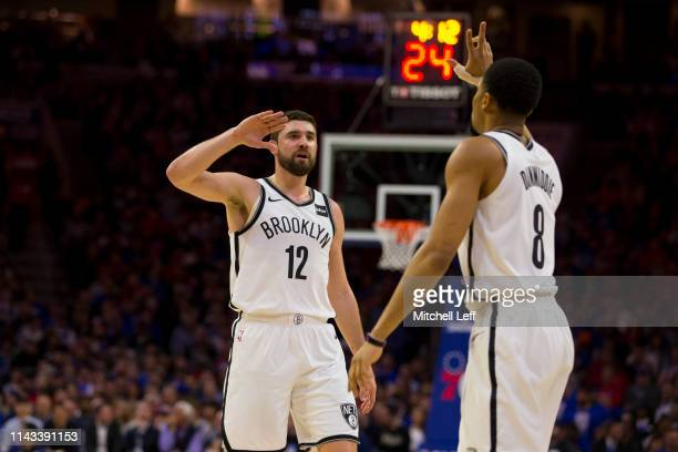 Joe Harris of the Brooklyn Nets high fives Spencer Dinwiddie against the Philadelphia 76ers in Game Two of Round One of the 2019 NBA Playoffs at the...
