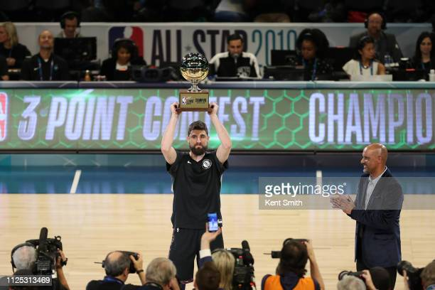 Joe Harris of the Brooklyn Nets holds the 2019 Mtn Dew 3Point Contest trophy during the 2019 Mtn Dew 3Point Contest as part of the State Farm AllStar...
