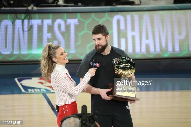 Joe Harris of the Brooklyn Nets holds the trophy after winning the 2019 Mtn Dew 3Point Contest as part of State Farm AllStar Saturday Night on...