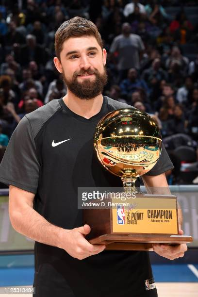 Joe Harris of the Brooklyn Nets holds up the 3Point Contest trophy after winning the 2019 Mtn Dew 3Point Contest as part of the State Farm AllStar...