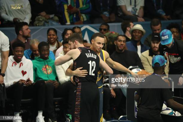 Joe Harris of the Brooklyn Nets hugs Stephen Curry of the Golden State Warriors during the 2019 Mtn Dew 3Point Contest as part of State Farm AllStar...