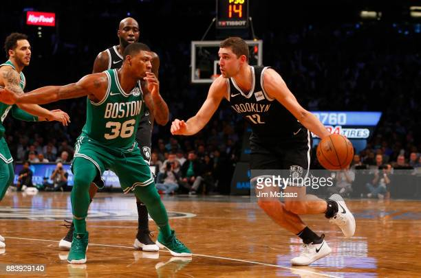 Joe Harris of the Brooklyn Nets in action against Marcus Smart of the Boston Celtics at Barclays Center on November 14 2017 in the Brooklyn borough...