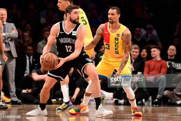 Joe Harris of the Brooklyn Nets is defended by George Hill of the Milwaukee Bucks at Barclays Center on April 01 2019 in New York City The Bucks...