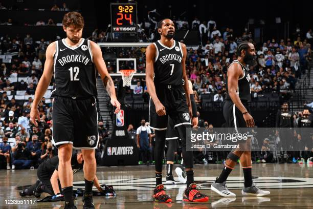 Joe Harris of the Brooklyn Nets, Kevin Durant of the Brooklyn Nets, and James Harden of the Brooklyn Nets look on during Round 2, Game 7 on June 19,...