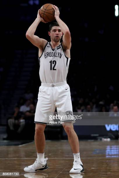 Joe Harris of the Brooklyn Nets looks down the court against the Miami Heat in the second half during their Pre Season game at Barclays Center on...