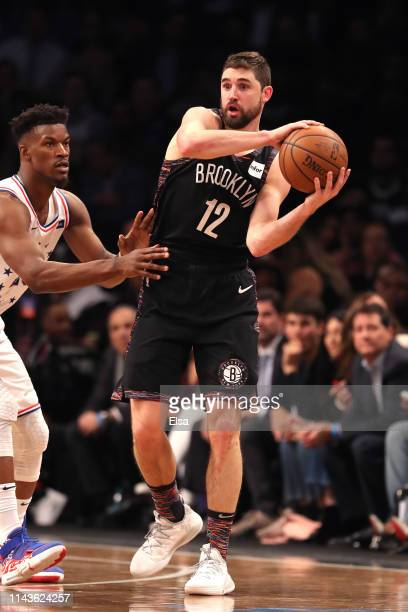 Joe Harris of the Brooklyn Nets looks to pass against Jimmy Butler of the Philadelphia 76ers in the third quarter during game three of Round One of...