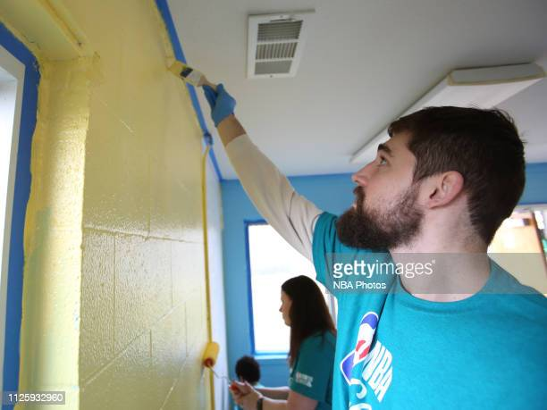 Joe Harris of the Brooklyn Nets paints a wall during the 2019 NBA Cares AllStar Day of Service at United Way of Central Carolina Project on February...