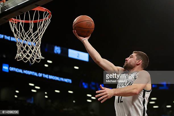 Joe Harris of the Brooklyn Nets puts up a layup during the first half of the preseason game against the Boston Celtics at Barclays Center on October...