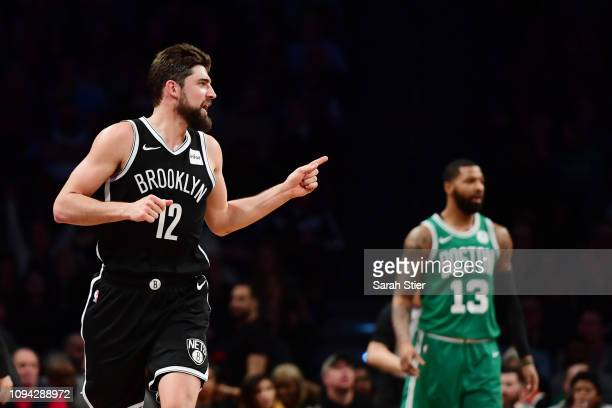 Joe Harris of the Brooklyn Nets reacts after making a threepoint basket during the second quarter of the game against the Boston Celtics at Barclays...