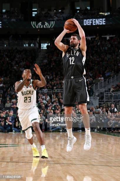 Joe Harris of the Brooklyn Nets shoots a three point basket against the Milwaukee Bucks on April 6 2019 at the Fiserv Forum Center in Milwaukee...