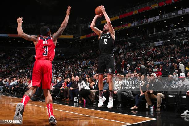 Joe Harris of the Brooklyn Nets shoots a threepointer during the game against Bradley Beal of the Washington Wizards on December 14 2018 at Barclays...