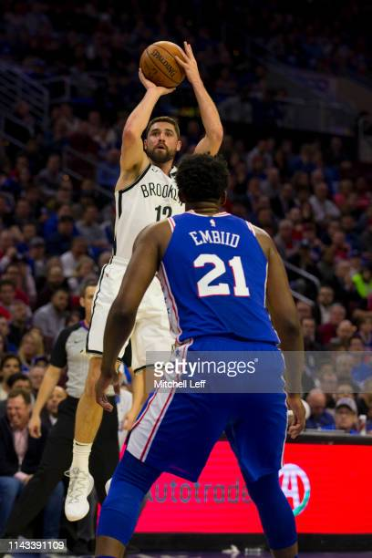 Joe Harris of the Brooklyn Nets shoots the ball against Joel Embiid of the Philadelphia 76ers in Game Two of Round One of the 2019 NBA Playoffs at...