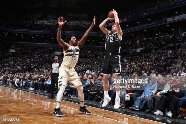 Joe Harris of the Brooklyn Nets shoots the ball against Sterling Brown of the Milwaukee Bucks on February 4 2018 at Barclays Center in Brooklyn New...