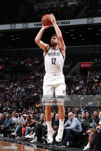 Joe Harris of the Brooklyn Nets shoots the ball against the New York Knicks during a preseason game on October 3 2018 at Barclays Center in Brooklyn...