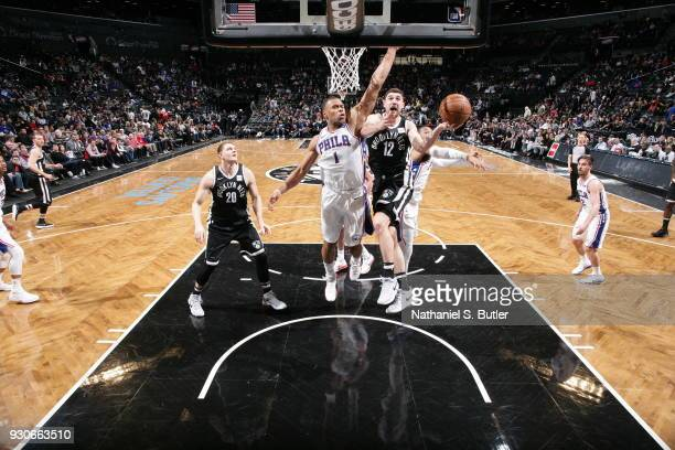 Joe Harris of the Brooklyn Nets shoots the ball during the game against the Philadelphia 76ers on March 11 2018 at Barclays Center in Brooklyn New...