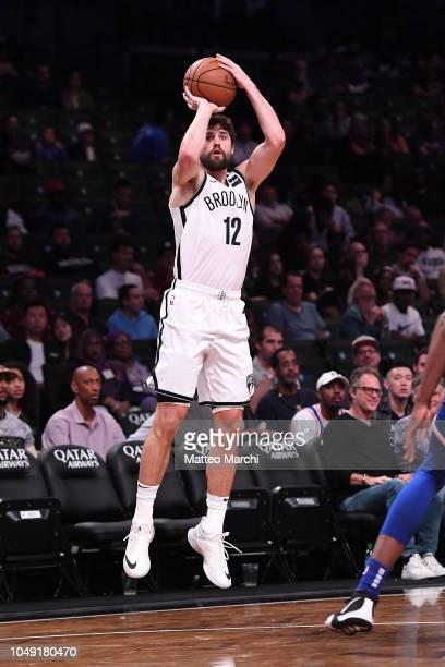Joe Harris of the Brooklyn Nets shoots the ball during the preseason game against the New York Knicks at Barclays Center on October 3 2018 in the...