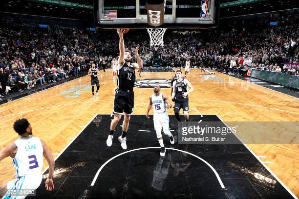 Joe Harris of the Brooklyn Nets shoots the gamewinning shot against the Charlotte Hornets on December 26 2018 at Barclays Center in Brooklyn New York...