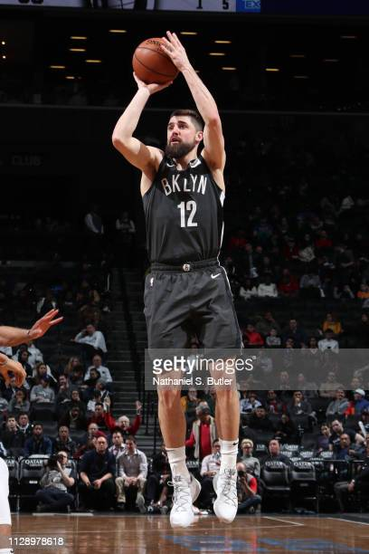 Joe Harris of the Brooklyn Nets shoots three point basket against the Cleveland Cavaliers on March 6 2019 at Barclays Center in Brooklyn New York...
