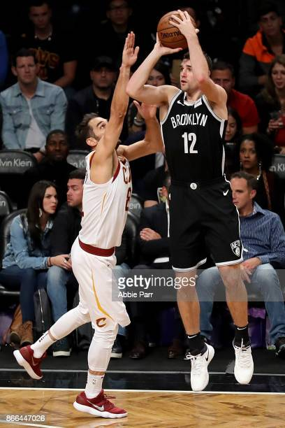 Joe Harris of the Brooklyn Nets takes a shot against Jose Calderon of the Cleveland Cavaliers in the second half during their game at Barclays Center...
