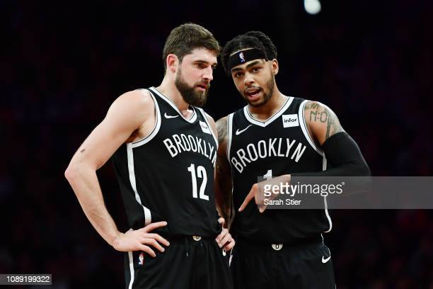 Joe Harris of the Brooklyn Nets talks with teammate D'Angelo Russell during a timeout in the fourth quarter of the game against the New Orleans...