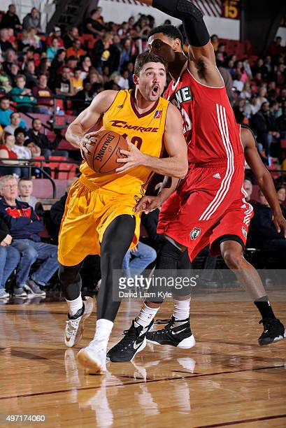 Joe Harris of the Canton Charge drives to the hoop against Jordon Mickey of the Maine Red Claws at the Canton Memorial Civic Center on November 14...
