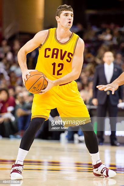 Joe Harris of the Cleveland Cavaliers looks for a pass during the second half of a preseason game against the Dallas Mavericks at Quicken Loans Arena...