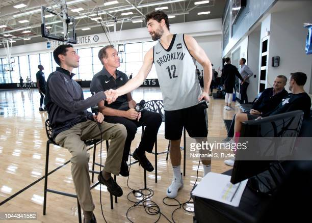 Joe Harris with broadcasters Chris Carrino and Tim Capstraw of the Brooklyn Nets during practice on September 27, 2018 at HSS Training Center in...