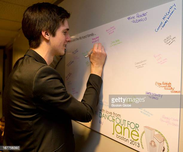 Joe Harrison one of the event coordinators signs a card backstage for Jane Richard during a benefit called Dance Out For Jane held at the John...