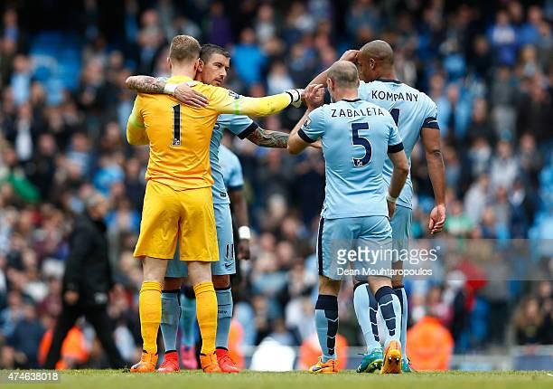 Joe Hart Aleksandar Kolarov Pablo Zabaleta and Vincent Kompany of Manchester City celebrate after the Barclays Premier League match between...