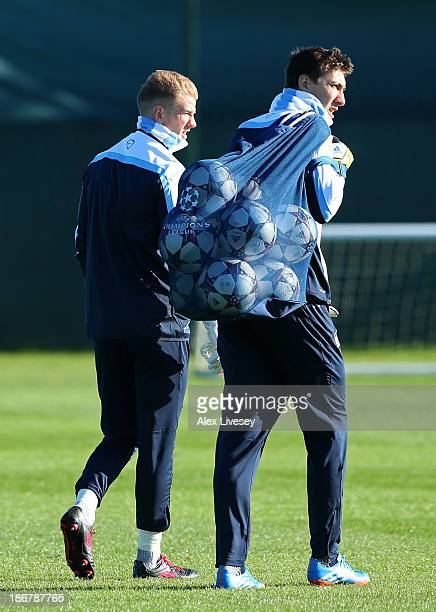 Joe Hart and Costel Pantilimon of Manchester City walk out for a training session at Carrington Training Ground on November 4 2013 in Manchester...