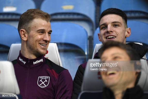 Joe Hart and Declan Rice of West Ham United talk on the bench prior to the Premier League match between Huddersfield Town and West Ham United at John...