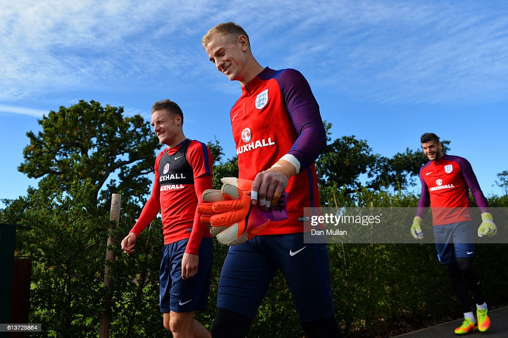 Joe Hart and Jamie Vardy walk out for an England training session at the Tottenham Hotspur training ground on October 10, 2016 in Enfield, England.