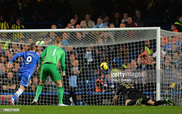 Joe Hart and Matija Nastasic of Manchester City look on as Fernando Torres of Chelsea scores their second goal during the Barclays Premier League...