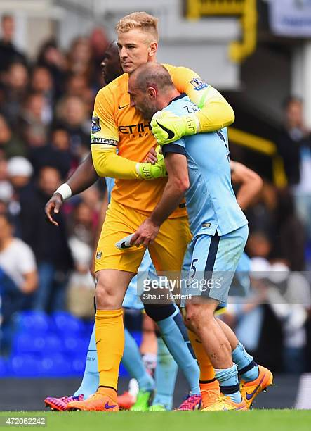 Joe Hart and Pablo Zabaleta of Manchester City embrace after the Barclays Premier League match between Tottenham Hotspur and Manchester City at White...