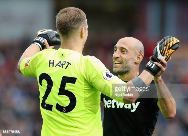 Joe Hart and Pablo Zabaleta of West Ham United celebrate their first goal during the Premier League match between Burnley and West Ham United at Turf...