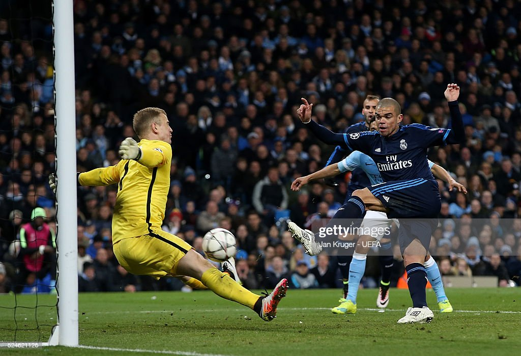 Joe Hart, Goalkeeper of Manchester City FC blocks a shot at goal from Pepe of Real Madrid during the UEFA Champions League semi final first leg match between Manchester City FC and Real Madrid on April 26, 2016 in Manchester, England.