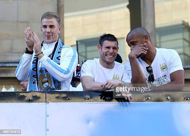 Joe Hart James Milner and Vincent Kompany look on during the Manchester City Premier League victory parade on May 12 2014 in Manchester England