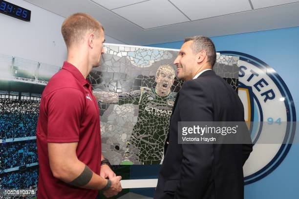 Joe Hart of Burnley is presented with a replica mosaic and life time season card by Chairman Khaldoon Al Mubarak to celebrate his time here at...